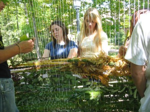 Casey and Megan collaborate on the nature weaving (Photo by Nancy Schwartz)