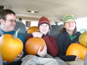 William, Hannah, and Kath share the van with a pile of pumpkins.