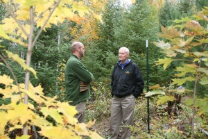 Teacher Andrew Milbauer and Trustee Ron Kazmar discuss the project.