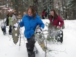 Leah B. and Annie take off their snowshoes to test how deep the snow is
