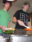 Students Eddy and Matt enjoying pancakes in Donahue House