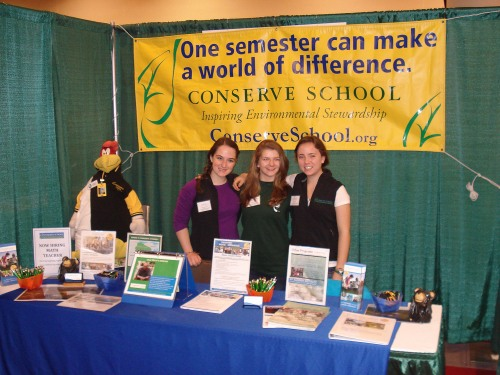 Foghorn, Kasey, Emma and Megan started the day in the Conserve School booth.
