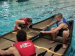 McKim and Jared stabilize the canoe as Ryan pulls himself back in.