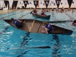 Lizzie and Selena submerge their canoe.