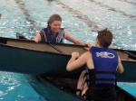 Lizzie and Selena work together to flip over the canoe during thier T-rescue