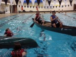 Gabe and Adam R. paddle over to rescue Kayleigh and Rosemary.