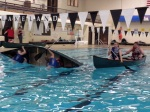 Mikaylo and Nell submerge their canoe, while Juliet and Jarrett get their canoe lined up for a T-rescue.