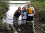Cara, Kit, and Nathan at a muddy portage