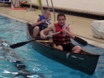 McKim and Jared paddle away from the edge of the pool.