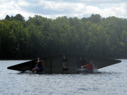 Tessa and Gwen flip their canoe.