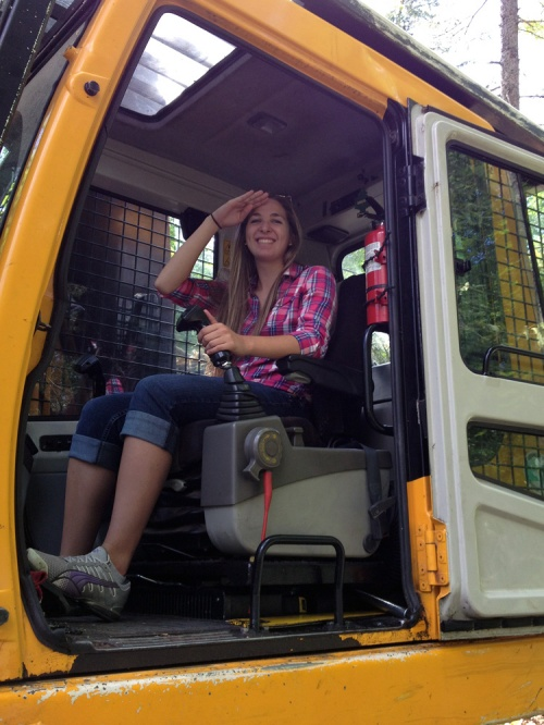 Kate sitting in the cab of the harvester