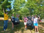 The students removing invasives from the shores of Black Oak Lake pose for a group shot.