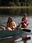 Reilly and Ana canoe across the lake.