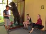 Samir, Julia, and Carolyn are accompanied by a grizzly as they do their small group work.