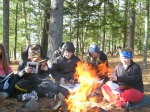 Students warm up while reading near the fire