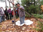 Roger LaBine demonstrates how to dance on dried wild rice so that the chaff seperates from the grain.