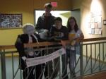 Luke, Mattie, and Maeve pose with their representation of Bill McKibben