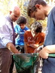 Andy, Samir, Aaron, and Dexter look for macroinvertebrates.