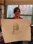 Jessie displays her charcoal drawing of Sacagawea