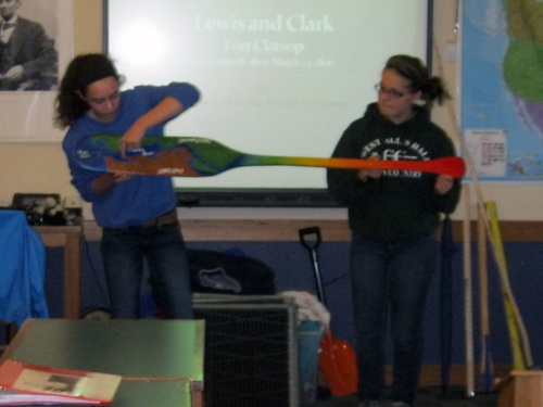 Mehan and Brook display their beuatifully painted hand-carved canoe paddle.