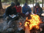 History students read near the fire