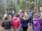 Field instructor Rebecca Deatsman showed the class some holes drilled in a tree by a Yellow-bellied Sapsucker.