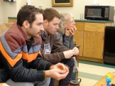 Art Teacher Nancy Schwartz and Graduate Fellows Dylan Fernandez and Greg Handley listen intently to a colleague.