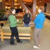 Trainers Jennifer Kobylecky and Anna Hawley and Assistant Head of School Mary Anna Thornton touch base during a break in the training.