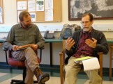 History Teacher Michael Salat and Science and Art Teacher Robert Eady discuss a reading.