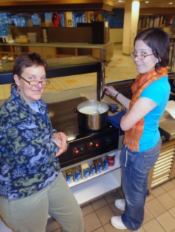 Cathy and grad fellow Rebecca stir the milk for the ricotta cheese.