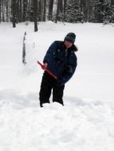 Dana tosses a shovelful of snow.