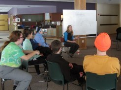 Field Instructor Jaime Bunting explains the quinzhee-building process.