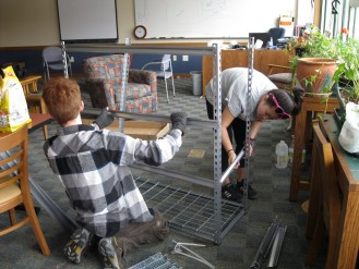 Connar and Madi assemble shelves for herb planters