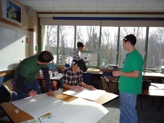 Josh, Jason, Nick, and Devan work on assembling the rest of the Phenology book