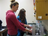 Kierra and Erin washing planters