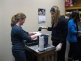 Maddie F. and Sabrina help sterilize planters