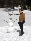 Joe poses with his completed snowman.