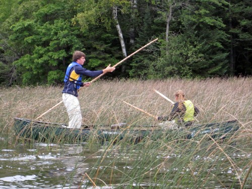 In 2012 Conserve School students practiced traditional wild rice harvesting at a local Native American ricing camp.