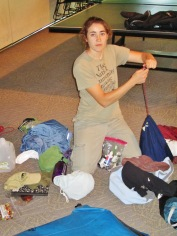 Donelle sorts through her gear before packing up.