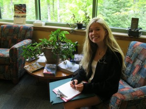 Becky works on an assignment in a scenic atrium.