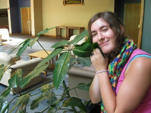 Krista admires the gathering space flora before lunch.