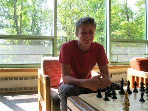 Max catches a game of chess before lunch.