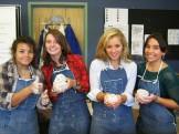 Ceramics students show off their pinch pots