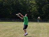 Cody executes a brilliant catch in an after-school Ultimate Frisbee match.