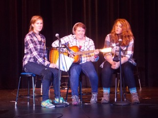 Heidi, Michelle, and Maya perform at the talent show for friends and family.