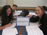 Kaya and Haddie work together on some textbook assignments, with a bit of fun thrown in.