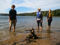 Charlie, Analiese and Jessica take a quick moment to make a cairn on Loon Lake.