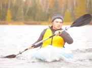 Cody kayaking in the thriathlon