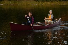 Chloe and Emily canoe through the still water of Big Bateau.