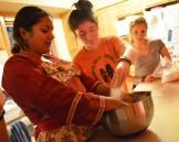 Zoe, Clara and Siri making roti